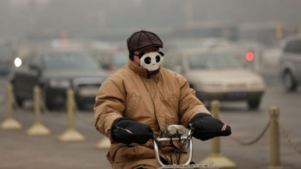 No laughing matter: A Beijing commuter wears a mask during severe pollution in the city on February 25.