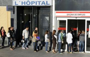 Job seekers line up at an employment office in Madrid.