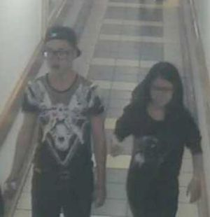 Police want to speak to this man, left, seen leaving the mall with a woman.