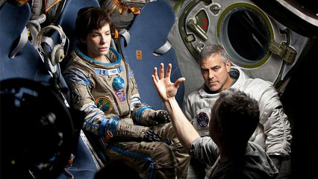 Astronomical bucks ... Sandra Bullock and George Clooney during the filming of Alfonso Cuarón's space epic <i>Gravity</i>.
