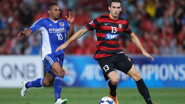 Tough initiation: Rafinha of Ulsan Hyandai competes with Western Sydney's Matthew Spiranovic during the Asian Champions ...