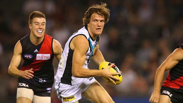 Port Adelaide's Jared Polec, with 16 AFL games under his belt, bursts away at Etihad Stadium on Tuesday night.