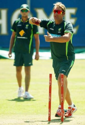 Shane Warne bowls during an Australian nets session at Newlands Stadium.