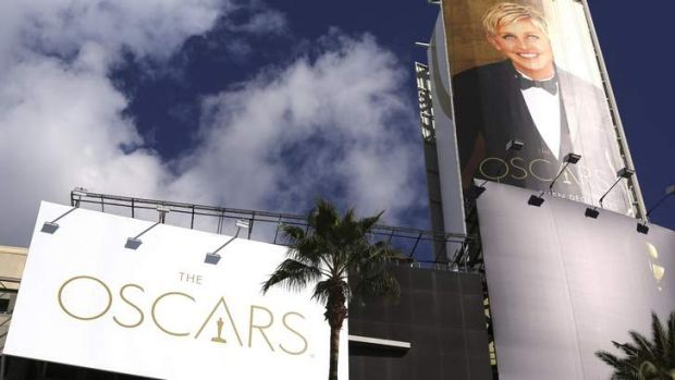 Getting ready ... comedian Ellen DeGeneres' billboard is raised above the Oscars red carpet at the Dolby Theater in ...