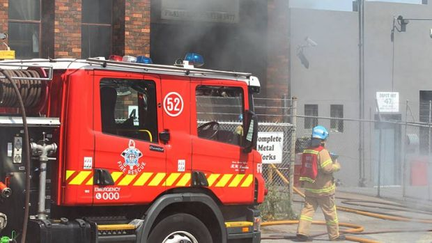 Fire fighters battle the blaze in Airport West