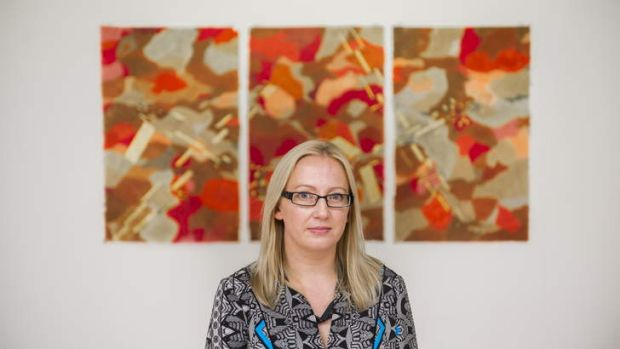Portrait of Canberra artist Katy Mutton with her work, Harbingers, at the Canberra Contemporary Art Space.