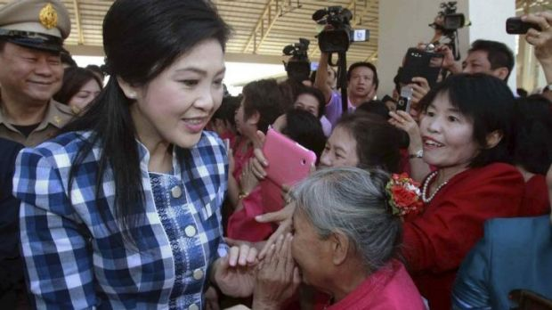 Government stronghold: Supporters greet Thailand's Prime Minister Yingluck Shinawatra (front L) in the northern town of ...