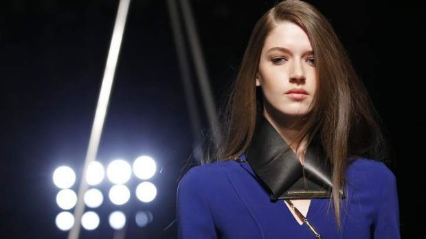 A model presents a creation by French designer Roland Mouret.