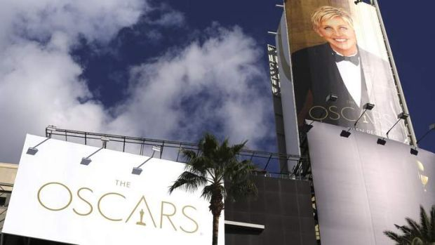 An image of comedian Ellen DeGeneres is seen next to an Oscars billboard raised above the red carpet before the 86th ...