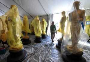 Statues of the Oscars remain in a tent before being transported to the red carpet and Dolby Theatre amid continuing ...