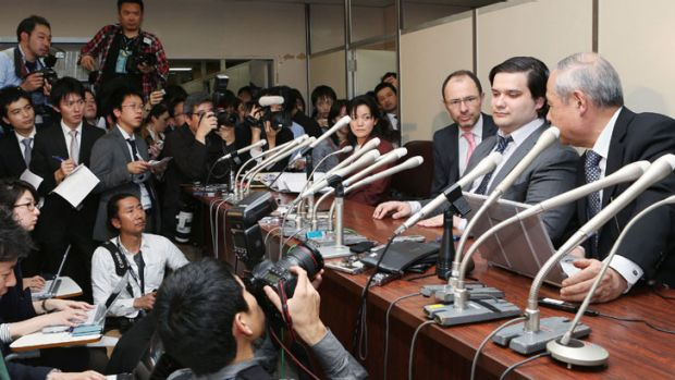 Mark Karpeles (2nd R), president of MtGox bitcoin exchange speaks during a press conference in Tokyo on February 28, ...