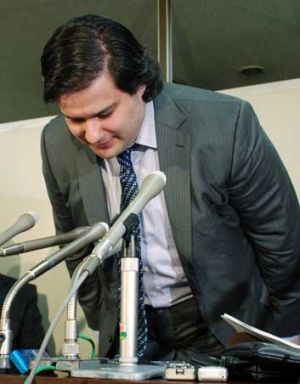 Mark Karpeles, president of MtGox bitcoin exchange bows his head during a press conference in Tokyo on February 28, ...
