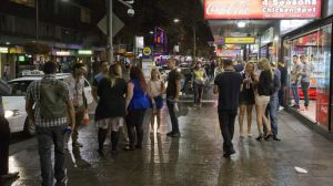 Homeward bound: partygoers fill the streets of Kings Cross on the first weekend of new lockout laws