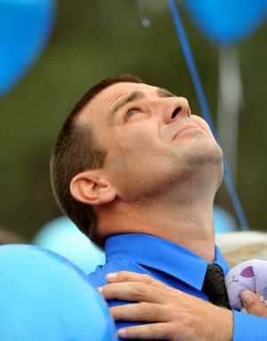 James Wright looks up to the sky as balloons are released at his Bridget's memorial.