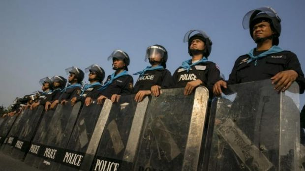 Riot police stand guard at the National Anti-Corruption Commission office in Nonthaburi province, on the outskirts of ...