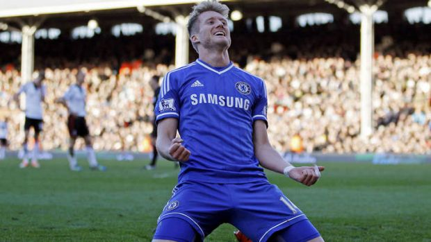 Chelsea's German striker Andre Schurrle celebrates scoring his third goal to complete his hat-trick during the English ...