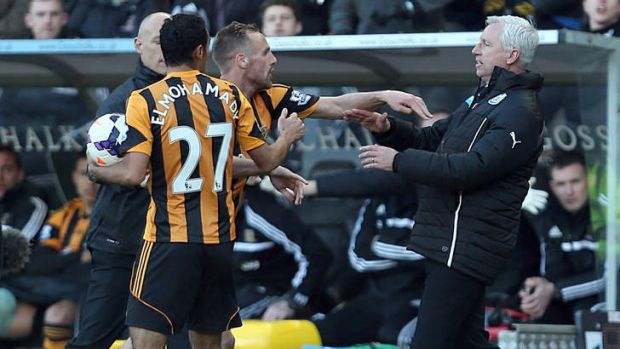 Newcastle United's manager Alan Pardew,  right,  and Hull City's David Meyler confront each other during the English ...