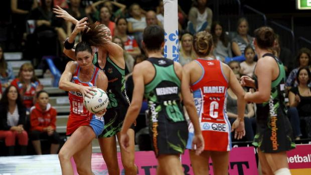 NSW Swifts recruit Sharni Layton grabs possession despite the efforts of the West Coast Fever defence.