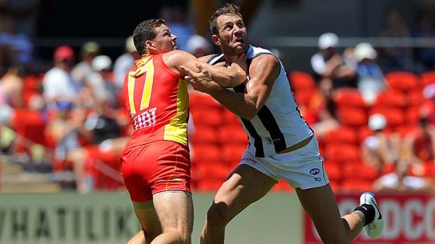 Travis Cloke and Steven May contest a mark.