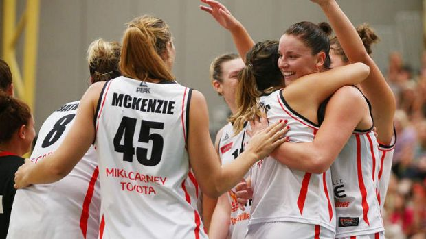 The Townsville Fire celebrate their win against the Dandenong Rangers.