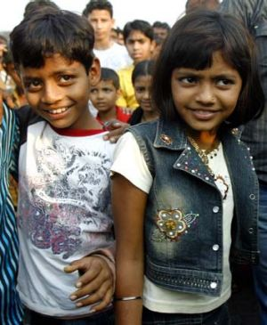 Azharuddin Ismail, left, who played the young Salim, and Rubina Ali, who played the young Latika at a Mumbai slum in 2009.