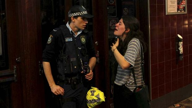 Exchange: A woman makes her point during a discussion with a police officer.