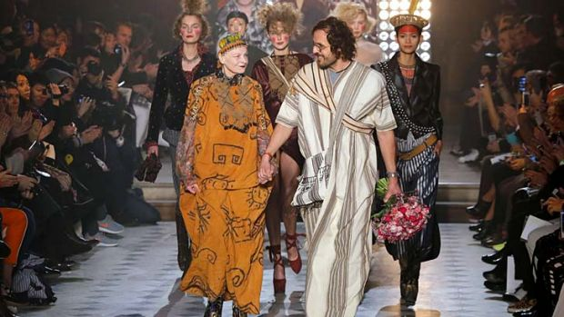 British designer Vivienne Westwood, left, and her husband Andreas Kronthaler acknowledge applause at the end of ...