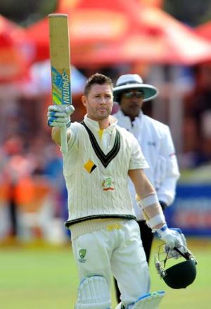 Australia's captain Michael Clarke gestures after reaching his century.