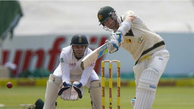 Michael Clarke drives for four.