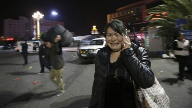 A woman reacts to the bloody attack outside Kunming railway station.