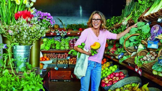 Sarah Wilson picks up some fresh fruits and vegetables at the market.