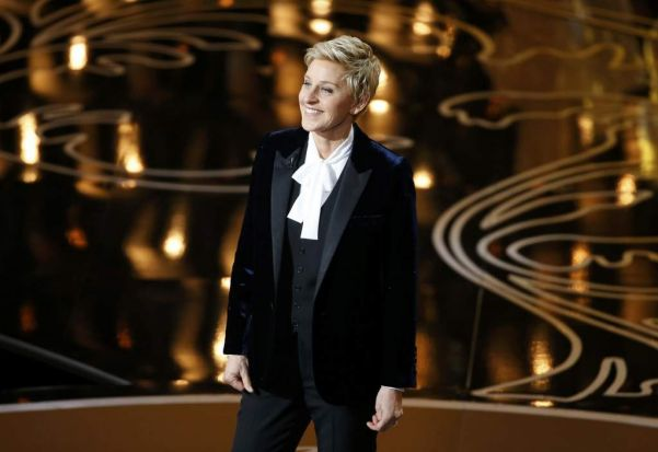 Ellen Degeneres takes the stage to host the show at the start of the 86th Academy Awards.