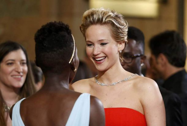 Jennifer Lawrence (R), best supporting actress nominee for her role in the film <i>American Hustle</i>, talks with ...