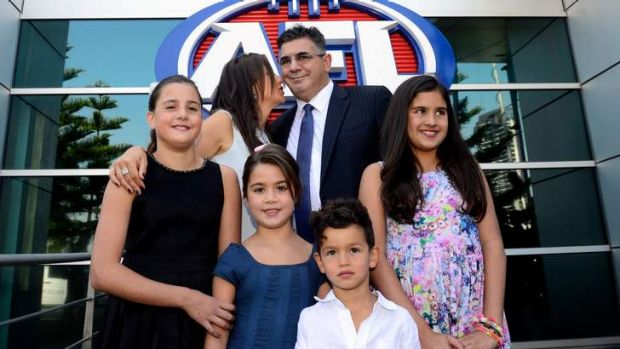 Family man: Andrew Demetriou with wife Symone and children (from left) Alexandra, Mattea, Sacha and Francesca.