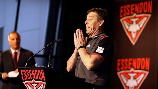 Let us pray: Coach Mark Thompson addresses the Bombers faithful at the club's season launch.
