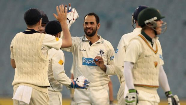Fawad Ahmed celebrates one of  his four wickets.