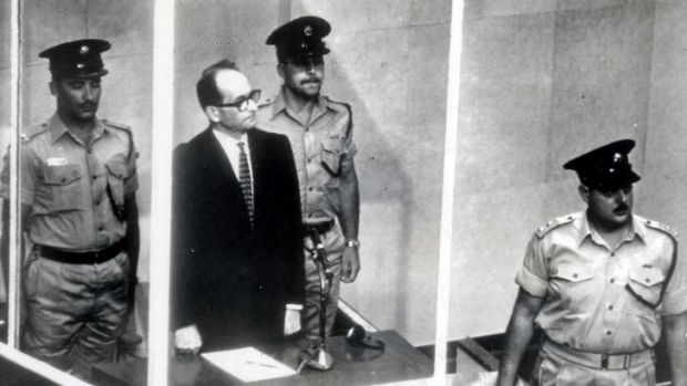 """Guilty before God"" ... former senior Nazi Adolf Eichmann stands in a glass cage during his 1961 trial in an Israeli ..."