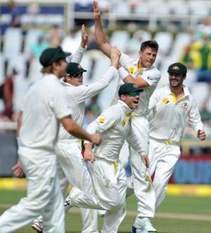 Australia's James Pattinson (2nd R) celebrates with teammates after taking the wicket of Dean Elgar.