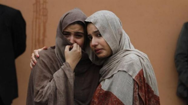 Women mourn at the hospital where victims' bodies were taken.
