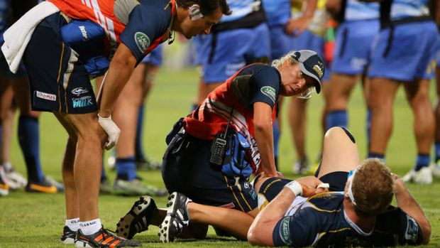 More scans ... David Pocock of the Brumbies receives medical attention to his knee during the round three Super Rugby ...