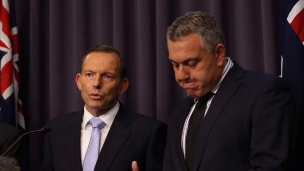 Prime Minister Tony Abbott and Treasurer Joe Hockey announce the government's position on Qantas on Monday.