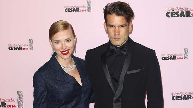 Scarlett Johansson and  Romain Dauriac arrive for the 39th Cesar Film Awards 2014 at Theatre du Chatelet on February 28, ...