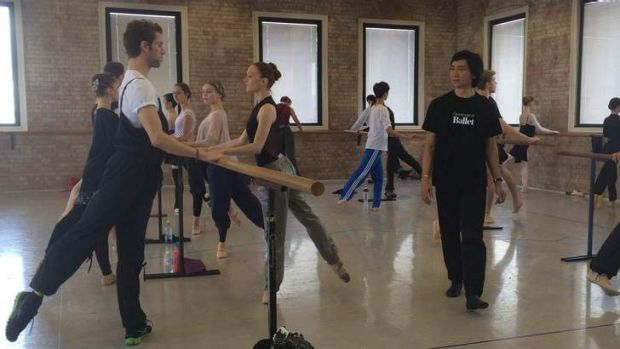 Queensland Ballet artistic director Li Cunxin walks American dancers James Whiteside and Gillian Murphy through a class ...