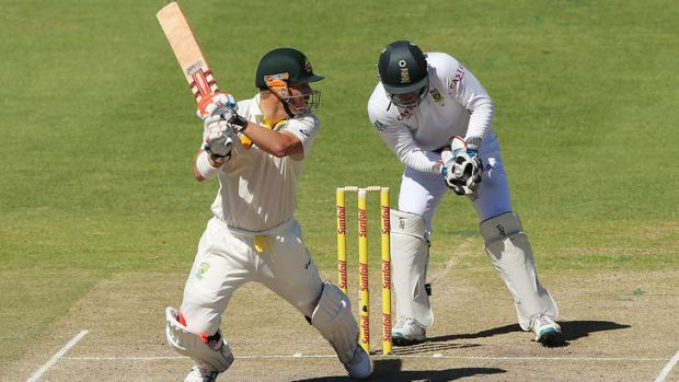 David Warner cuts backward of point during the deciding Test at Cape Town.