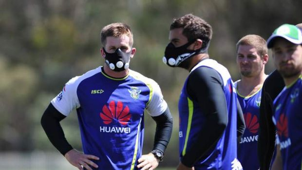 PEAK FITNESS: Raiders players, including Josh McCrone, at left, try out the elevation training masks on Tuesday which ...