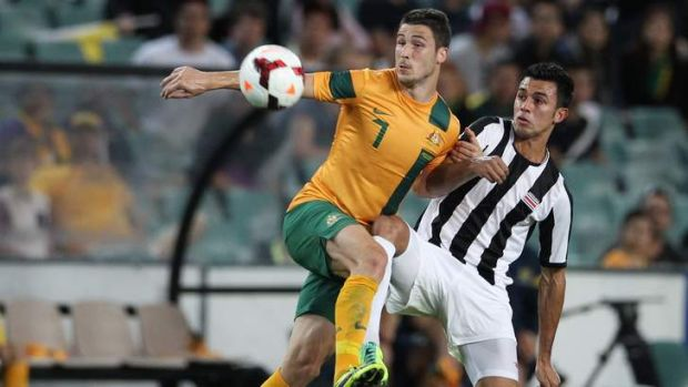 On the move: Socceroo Mathew Leckie contests the ball against Costa Rica in Sydney.