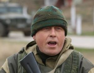A soldier under Russian command warns unarmed Ukrainian troops that he will shoot