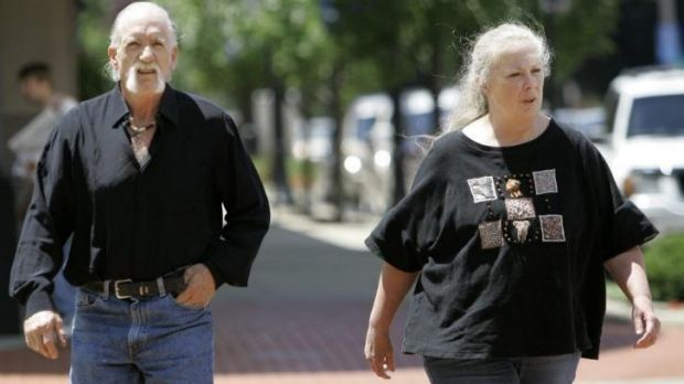 Forced adopted children to sleep in cages ... Michael and Sharen Gravelle walk through downtown Norwalk, Ohio.