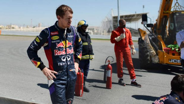 Sebastian Vettel looks on after his car broke down during pre-season testing in Bahrain.