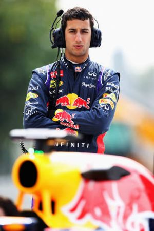 Australian driver Daniel Ricciardo watches the team practise pitstops in Bahrain.